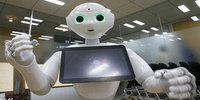 Robot Ques in Line for new iPhone's